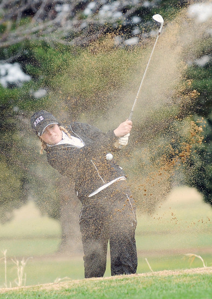 Berthoud High School junior Brandi Peter blasts out of a sand trap during a city golf tournament Wednesday, April 6, 2011 at The Olde Course in Loveland.