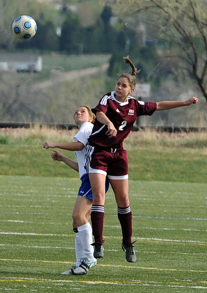 Berthoud High's #2 Sara Sterck and Resurrection Christian's #7 Megan Bush go up for a header Monday during their game at thte Loveland Sports Park.