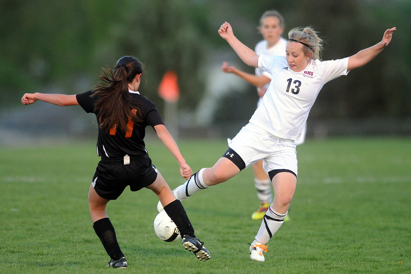 Berthoud High School junior Chloe Murray, right, goes against Mead's Danielle Higgins in the first half of their game Tuesday, April 24, 2012 at Marr Field.