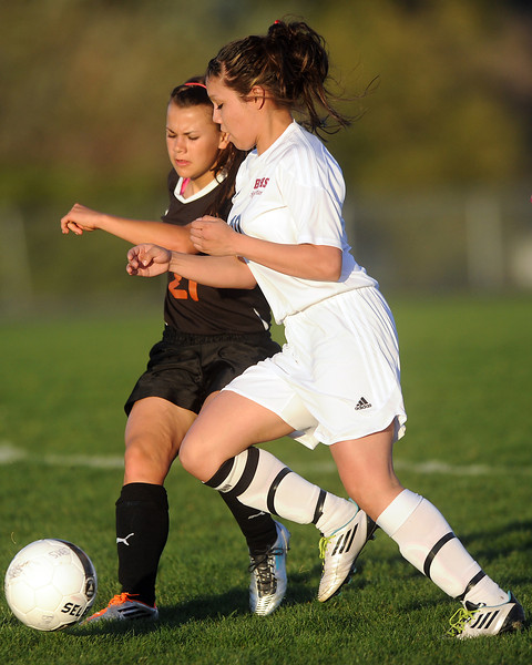 Berthoud High School's Diana Martinez, left, and Mead's Acacia Stephen battle for control of the ball in the first half of their game Tuesday, April 24, 2012 at Marr Field.