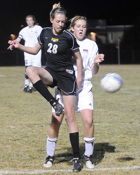 Thompson Valley High School freshman Paige Chase, front, and Berthoud freshman Lindsey Loberg battle for the ball in the first half of their game on Wednesday, March 17, 2010 at Marr Field.