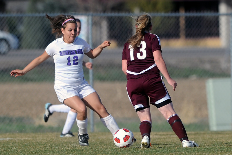 Mountain View High School's Paulina Barraza, left, and Berthoud's Chloe Murray converge on the ball in the second half of their game Wednesday, March 28, 2012 at MVHS.