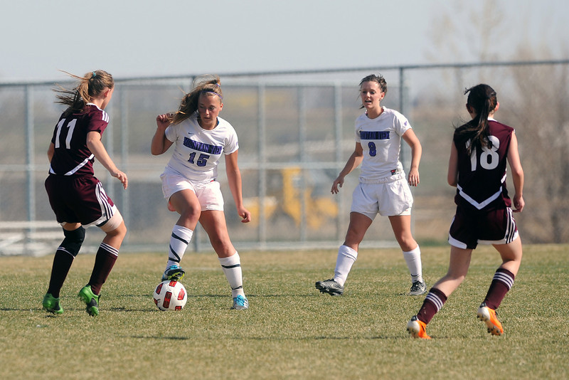 Berthoud High School's Stefani Messick, left, Mountain View's Tessa Armstrong and Kelli Hlushak and Berthoud's Gioconda celentano in the first half of their game Wednesday, March 28, 2012 at MVHS.