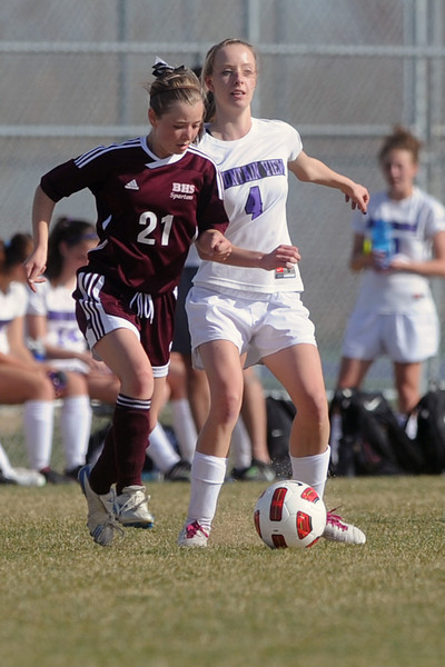 Berthoud High School's Savanna Seat, left, dribbles around Mountain View's Jessie Rollstin in the first half of their game Wednesday, March 28, 2012 at MVHS.