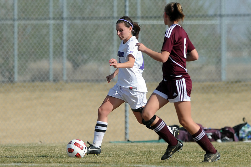 Mountain View High School senior Emily McFeron, left, dribbles around Berthoud's McKenna Nauss in the first half of their game Wednesday, March 28, 2012 at MVHS.