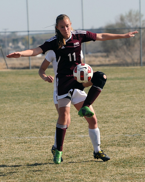 Berthoud High School's Stefani Messick goes up for the ball ahead of Mountain View's Abbey Metzger in the first half of their game Wednesday, March 28, 2012 at MVHS.