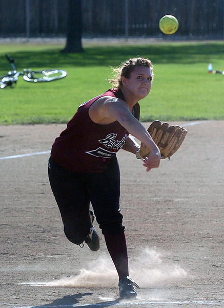 Berthoud High School third baseman Danielle Wikre makes a throw to first after fielding a ball during a game in September against Roosevelt at BHS.