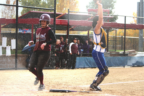 Berthoud senior Danielle Wikre crosses home in the rain during their second game in the state championship October 22, 2010 at Aurora Sports Park. <br /> Photo by Jenn LeBlanc