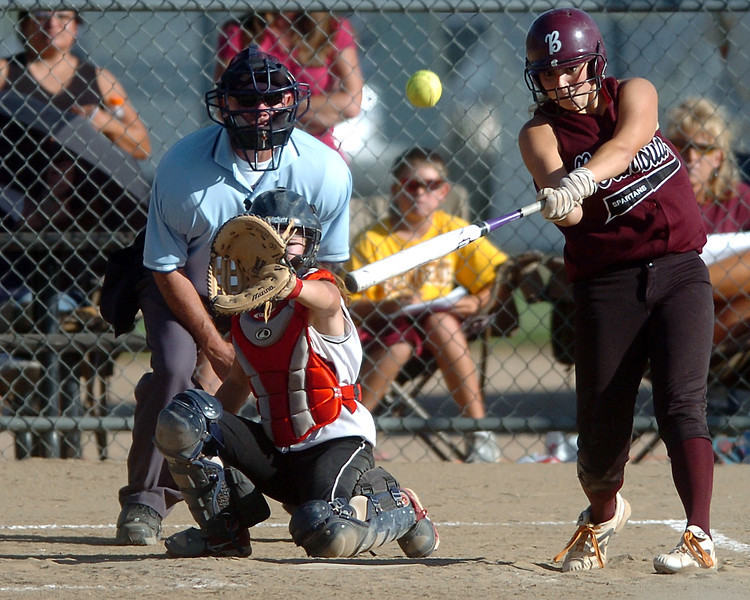 Berthoud High School sophomore Morgan Thonhoff smacks a double as Roosevelt catcher Morgan Devine works behind the plate in the bottom of the fifth inning of their game Tuesday at BHS.