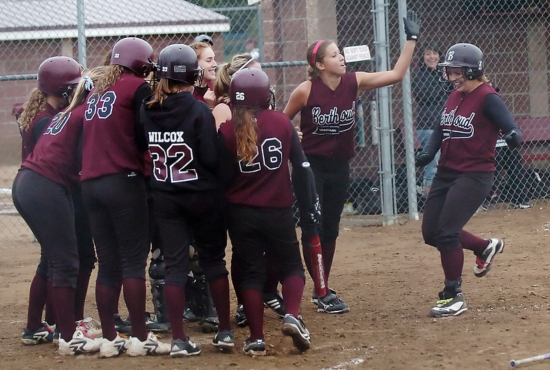 Berthoud High School sophomore Lindsey Karlin, right, is greeted by teammates at home plate after hitting a three-run home run in the bottom of the third inning of a game against Thompson Valley on Wednesday at BHS.
