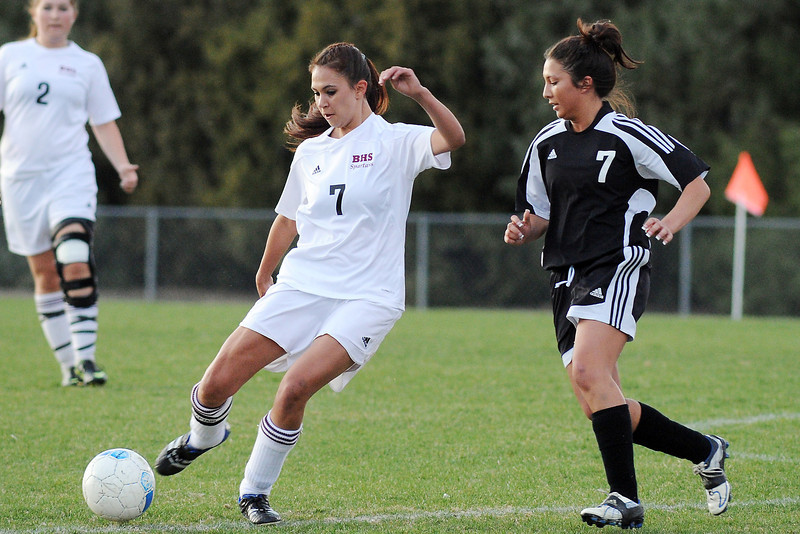 Berthoud High School's Cherokee Walker, middle, works against Roosevelt's Bre McNeil while Megan Loberg (2) looks on in the first half of their game on Monday, April 29, 2013 at Marr Field.