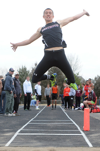 Berthoud High School junior Ryan Vasquez flies through the air toward the pit while competing in the long jump during the Max Marr Invitational on Saturday, April 13, 2013 at BHS.