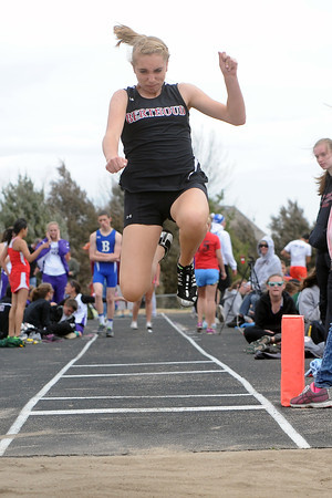 Berthoud High School's Sierra Messick competes in the long jump during the Max Marr Invitational on Saturday, April 13, 2013 at BHS.