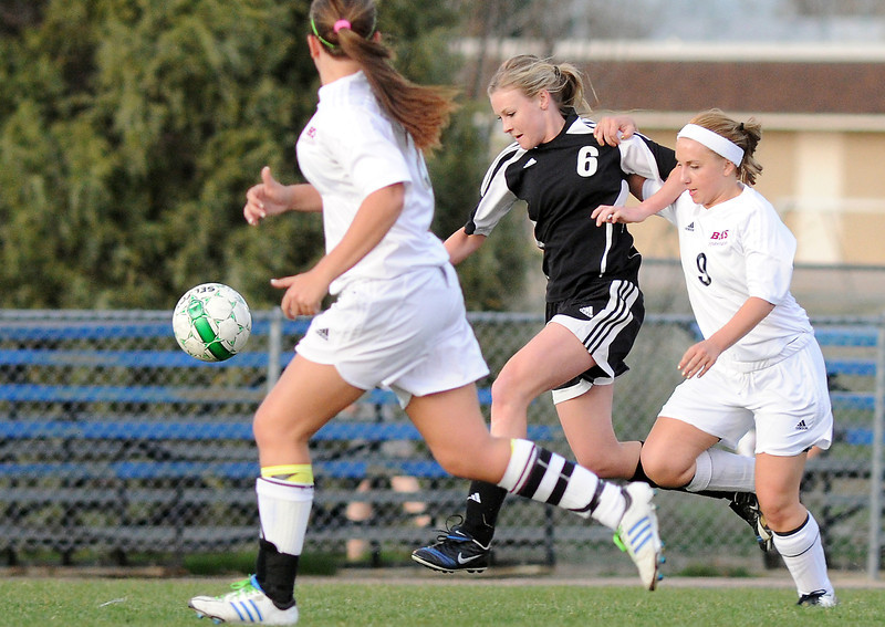 Berthoud High School's Amy Taylor, right, and Roosevelt's Paige Eldridge battle for control of the ball while Alisha Black looks on in the first half of their game  on Monday, April 29, 2013 at Marr Field.