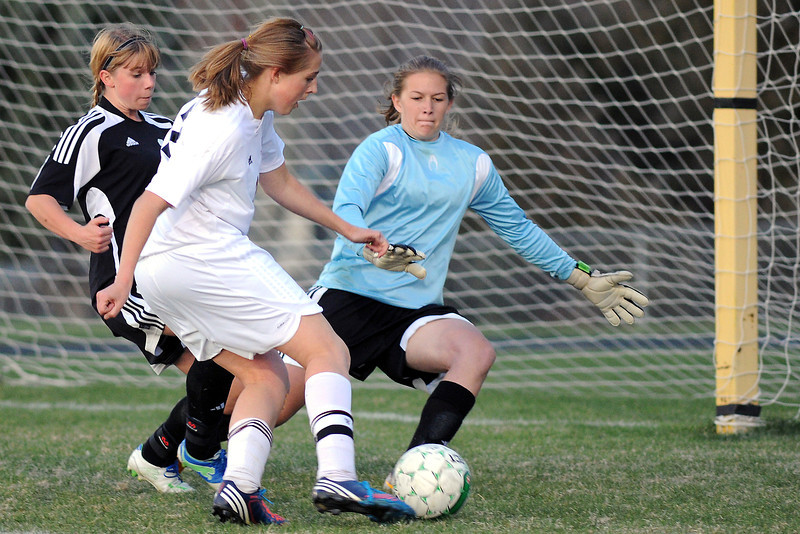 Roosevelt High School goalie Kelsey Kammerzell, right, and sweeper Jessica Meek, left, defend on a shot attempt by Berthoud's Lindsey Loberg in the first half of their game Monday, April 29, 2013 at Marr Field.