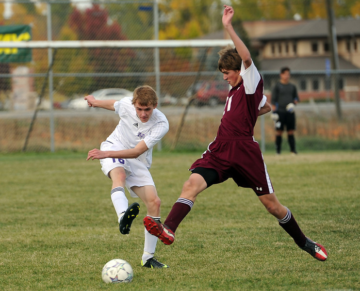 Mountain View's #16 Grayson Pike, left, and Berthoud's #21 Nathan Denesha battle for the ball during their game at Mountain View on Thursday, October 11, 2012.