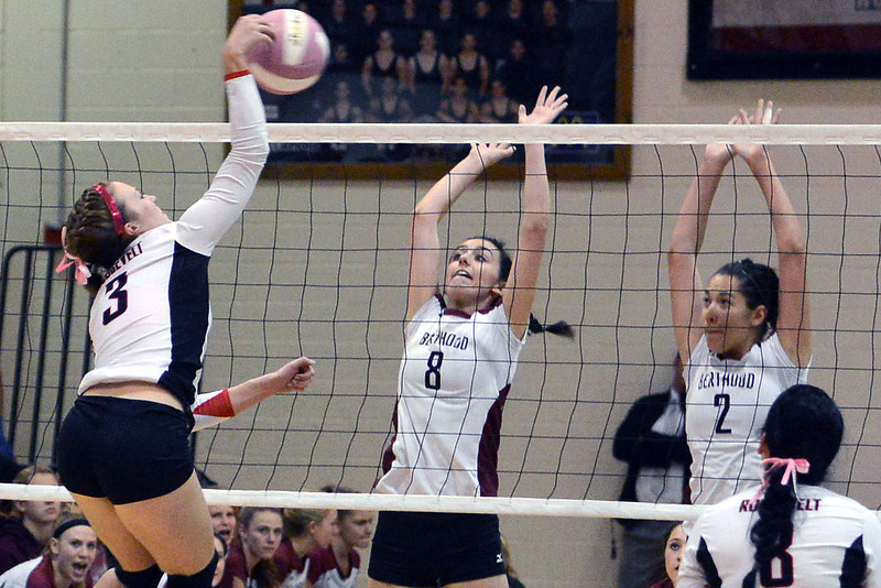 Roosevelt High School's Whitney Shawver, left, spikes the ball against Berthoud's Lynda Hutchins, middle, and Mimi Garcia (2) during set three of their match on Tuesday, Oct. 9, 2012 at RHS. The RoughRiders won, 3-1.
