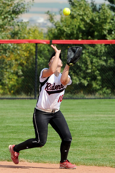 Roosevelt High School shortstop Madison Kilcrease catches a fly ball in the top of the sixth inning of a game against Berthoud on Saturday, Sept. 22, 2012 at Nelson Farm Park in Johnstown.