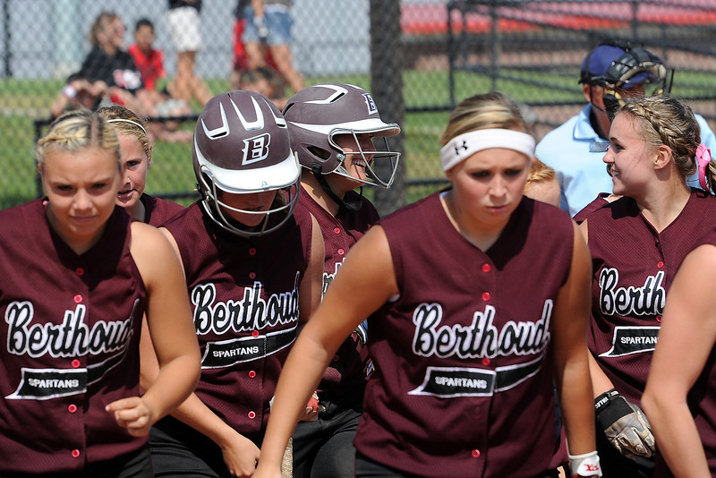 Berthoud High School's Mackenzie Villarreal, back row center, is congratulated by teammates at home plate after hitting a home run during a game against Roosevelt on Saturday, Sept. 22, 2012 at Nelson Farm Park in Johnstown.