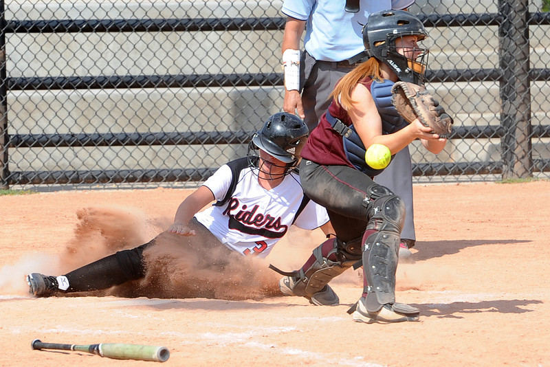 Roosevelt High School's Megan Flynn (3) scores ahead of the tag attempt by Berthoud catcher Lauren Bending in the bottom of the sixth inning of their game on Saturday, Sept. 22, 2012 at Nelson Farm Park in Johnstown.