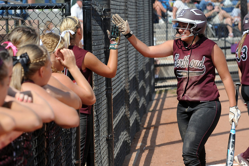 Berthoud High School's Sammie Villareal, right, is congratulated by her teammates after scoring a run in the top of the third inning of a game against Roosevelt on Saturday, Sept. 22, 2012 at Nelson Farm Park in Johnstown.