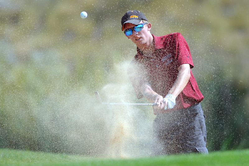 Berthoud High School senior Troy Johnson blasts out of a sand trap on No. 18 while competing in the Class 4A Regional Golf tournament on Wednesday, Sept. 19, 2012 at Indian Peaks Golf Course in Lafayette.