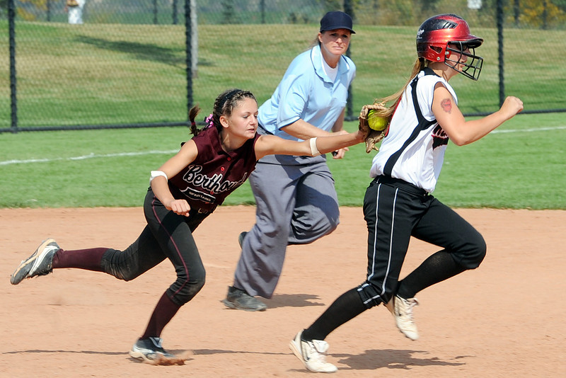 Berthoud High School shortstop Samie Kouns, left, tags out Roosevelt base runner Amanda Eidson in a rundown play while umpire Deb Ellison looks on in the bottom of the seventh inning of their game on Saturday, Sept. 22, 2012 at Nelson Farm Park in Johnstown.