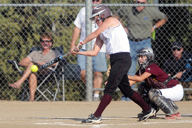 Berthoud High School's Jessica Boruff hits a double in front of Windsor catcher Shaela Heath in the bottom of the second inning of their game Thursday, Sept. 20, 2012 at Bein Park.