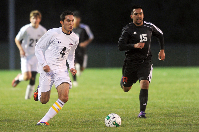 Berthoud High School midfielder Axel Ayala (4) and Roosevelt's Chris Portillo (15) sprint upfield during the first half of their match on Wednesday, Sept. 12, 2012 at Marr Field.