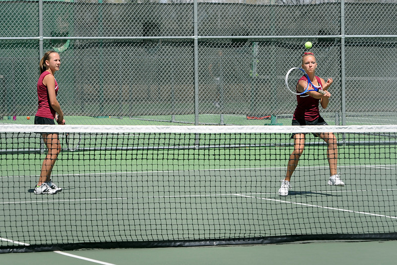 Berthoud High School's Laura Wolfe, right, returns a shot while her No. 3 doubles partner Hanna Nash looks on during their semi-final match for the Northern Colorado Invitational on Friday at Loveland High School.