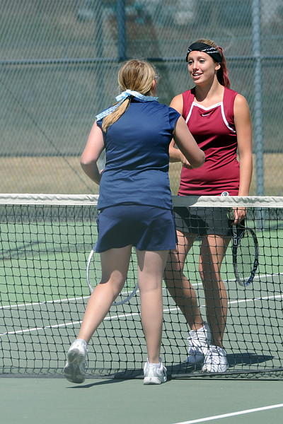 Berthoud High School's Kara Godebu, right, shakes hands with Valley Christian's Lauren Massey at the conclusion of their No. 1 singles match for the Northern Colorado Invitational on Friday, April 13, 2012 at LHS.