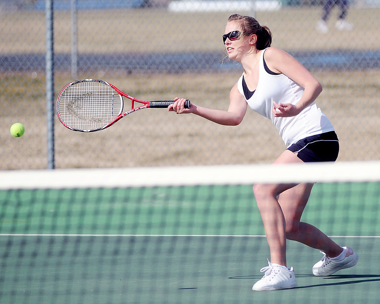 Berthoud High School's Kara Godebu returns a shot during her match against Erie's Kymberlee Whitley on Thursday, March 18, 2010 at BHS.