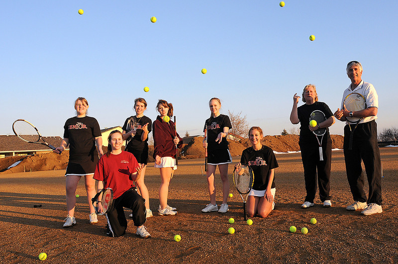 Seniors on the Berthoud High School tennis team stand Wednesday with their coaches on the site of their new tennis courts that are being built just east of the school. From left are Alicia Klepfer, Jenny Raak, Katie Essig, Jenny Baker, Britta Berg, Maya Lindgren, assistant coach Leigh Vitasek and head coach Dave Mathiesen.