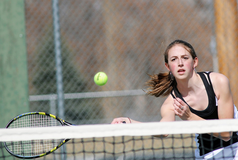 Berthoud High School's Sara Kemp hits a volley at the net during her No. 1 singles match against Erie's Mae Arvay on Thursday, March 18, 2010 at BHS.