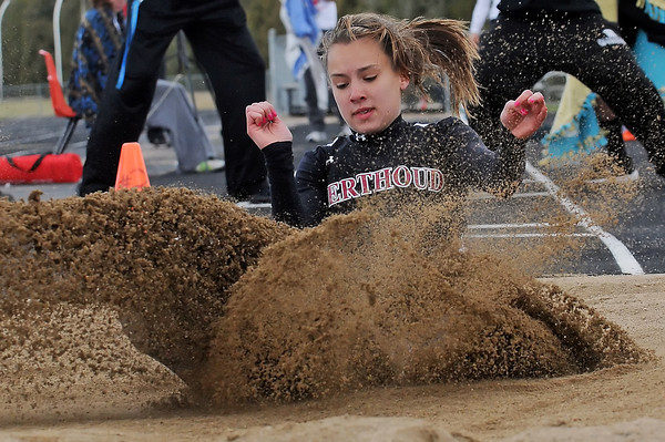 Berthoud High School senior Cheyenne Hall splashes down in the sand while competing in the long jump finals Saturday during the Spartan Invitational in Berthoud.