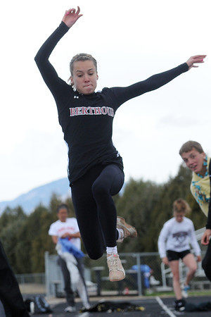 Berthoud High School senior Cheyenne Hall flies through the air while competing in the long jump finals Saturday during the Spartan Invitational in Berthoud.