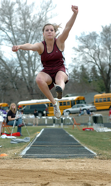 Berthoud High School's Courtney Mills performs a long jump Monday during a track meet at Roosevelt High School in Johnstown.