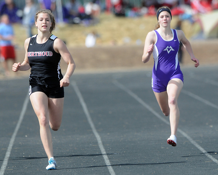 Berthoud High School junior Courtney Mills, left, and Mountain View junior Ashlee Wenrick sprint toward the finish line in a heat of the 200-meter run during the Randall Hess Invitational track meet on Saturday at Roosevelt High School in Johnstown.