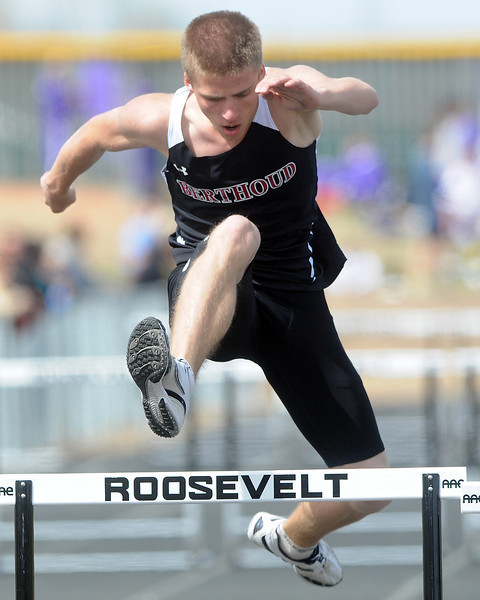 Berthoud High School sophomore Mythiasie Bold clears a hurdle during a heat of the 300-meter hurdles at the Randall Hess Invitational track meet on Saturday at Roosevelt High School in Johnstown.