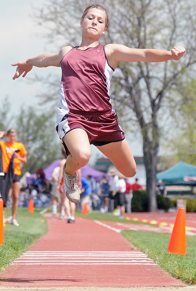 Berthoud High School sophomore Courtney Mills flies through the air while competing in the triple jump Thursday during the Class 4A State Track and Field Championships at Jeffco Stadium in Lakewood.