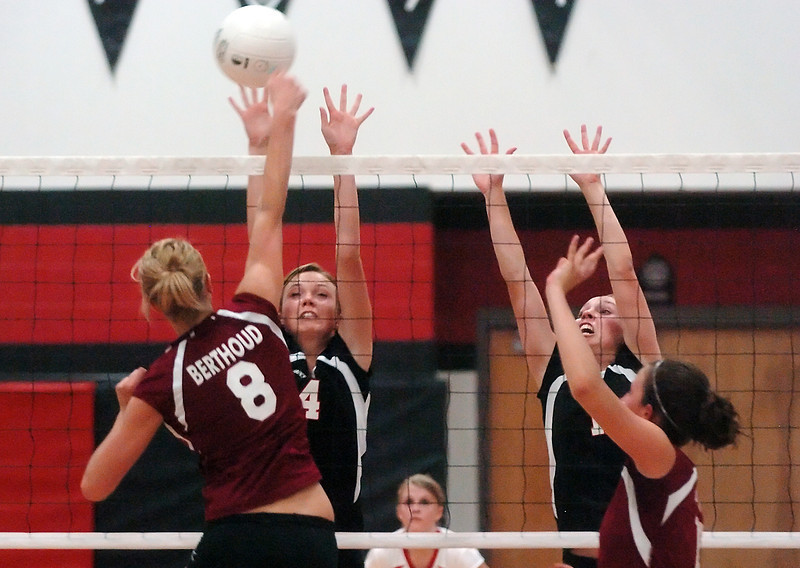 Loveland High School's Tehya Smith (4) and teammate Alyssa Steine go up against Berthoud's Elle Satterthwaite (8) and Lexie Yates in the second game of their match on Thursday, Sept. 9, 2010 at LHS. The Indians won, 3-0.