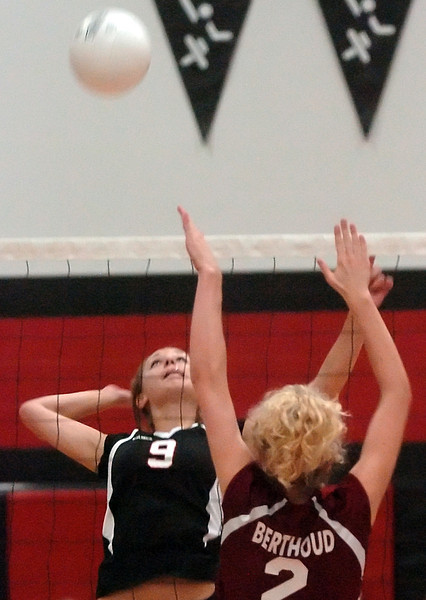 Loveland High School junior Pam Janicek (9) goes up against Berthoud's Clara Levy in game two of their match on Thursday, Sept. 9, 2010 at LHS. The Indians won, 3-0.