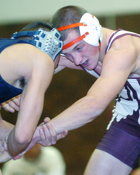 Berthoud High School junior Robbie Workman, right, grapples with Northridge's Chuy Melendez during their 125-pound match Thursday evening at BHS.