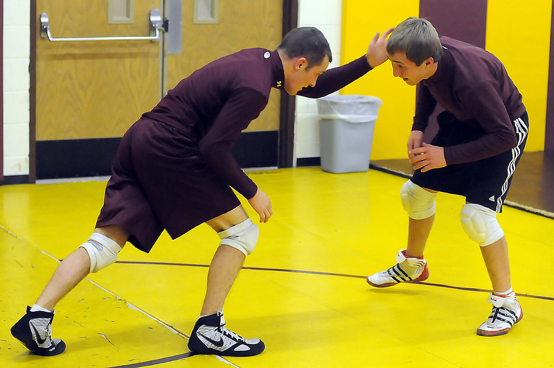 Berthoud High School senior Robbie Workman, left, and junior Tylor Zandt work on a drill together during wrestling practice on Wednesday at the school.
