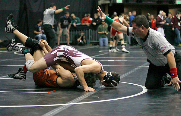 Berthoud's Robby Workman pins Mead's Alex Mead during the class 3A 135 lb. Colorado State Wrestling match on Thursday at the Pepsi Center. (Photo by Gabriel Christus)