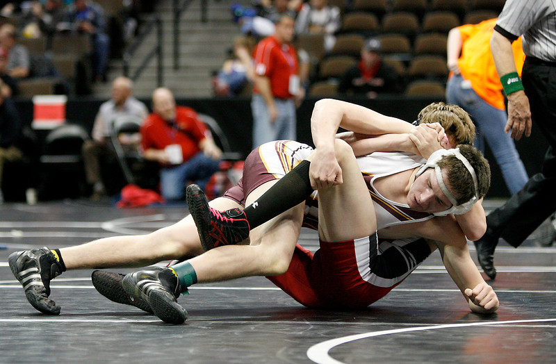 Berthoud's Cory Ellis tries to pin Strasburg's Quentin Bradshaw during the 3A 160 lb. Colorado State Wrestling match on Thursday at the Pepsi Center. (Photo by Gabriel Christus)