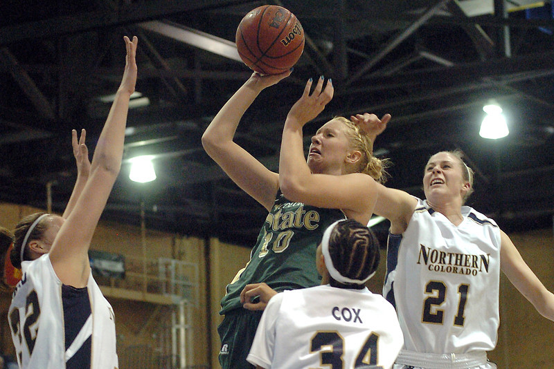Colorado State University sophomore Natalie van den Adel attempts a shot amid Northern Colorado defenders Jayne Strand, left, Whitley Cox and Lauren OOsdyke in the first half of their game Monday at Butler-Hancock Arena in Greeley. The Rams lost, 65-56.