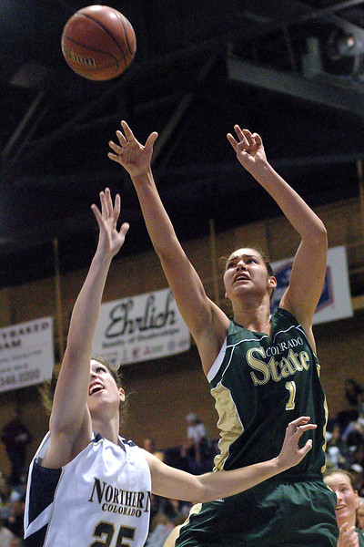 Colorado State University forward Chatilla van Grinsven takes a shot over Northern Colorado's Lara Merritt in the second half of their game Monday at Butler Hancock Arena in Greeley. The Rams lost, 65-56.
