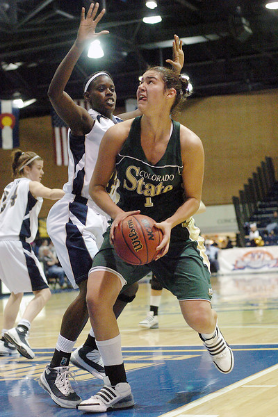 Colorado State University forward Chatilla van Grinsven drives to the basket around Northern Colorado's Brittany Fernandez in the first half of their game Mondayat Butler-Hancock Arena in Greeley. The Rams lost, 65-56.
