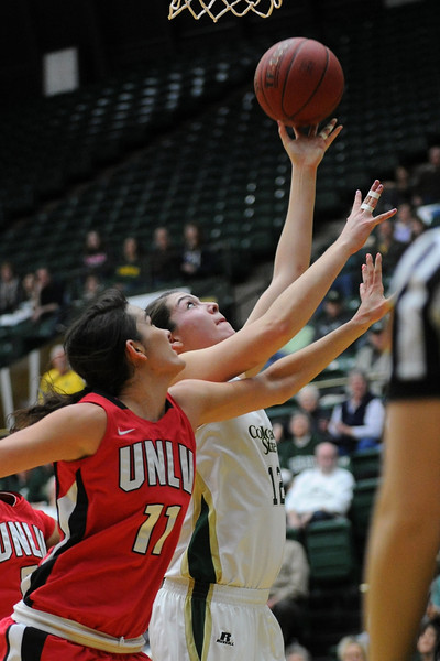 Colorado State sophomore Sam Martin, right, lays the ball up in front of Las Vegas' Jamie Smith in the first half of their game Wednesday, Feb. 1, 2012 at Moby Arena.